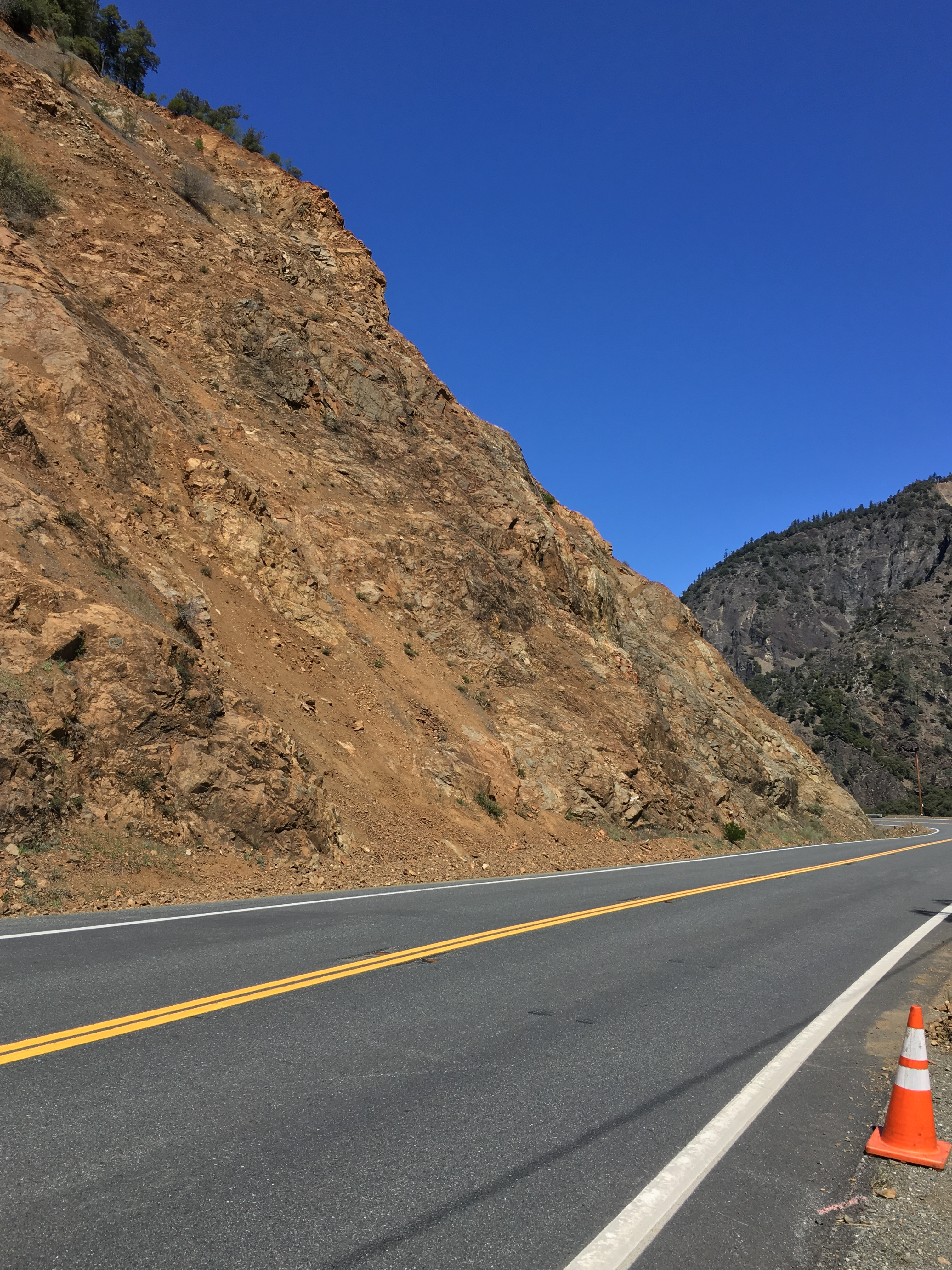 Picture of Highway 299, just east of Burnt Ranch, with large rock slope in the background