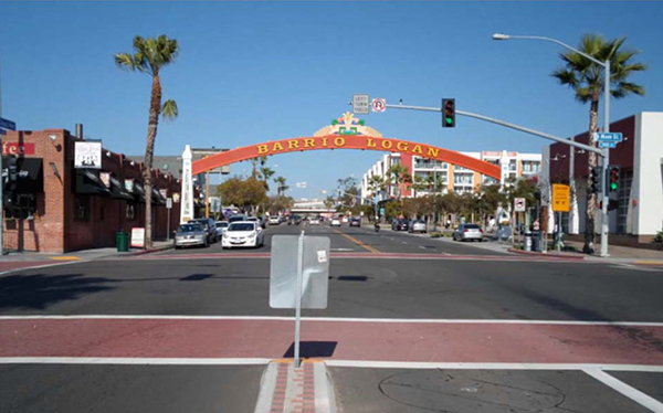 A 'small-town' looking multi-lane intersection with a decorative arch crossing the road.