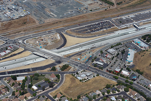 From above, a view of multi-lane roads intersecting with each other.
