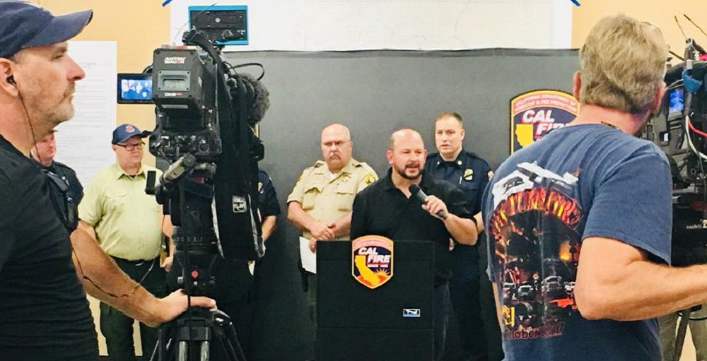 Caltrans District 2 Director Dave Moore participates in a CalFire press conference during the 2018 Carr Fire.