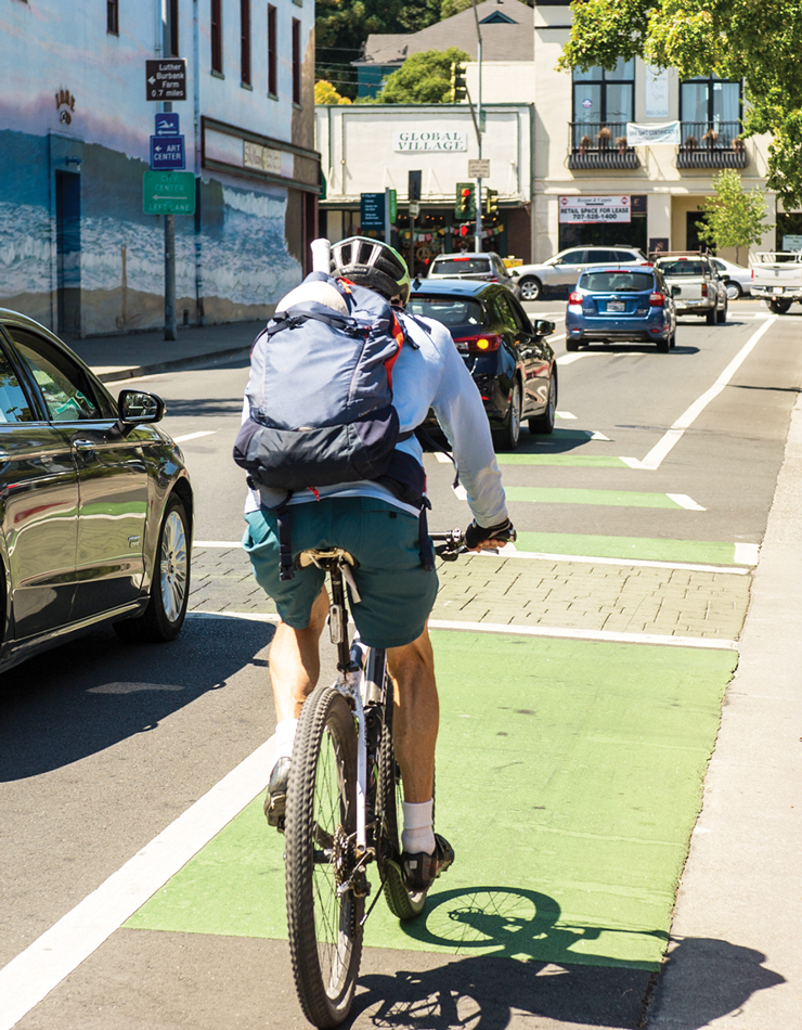 Photo of a bicyclist using a new bike lane