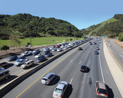 A photo depicting an overhead view of freeway traffic