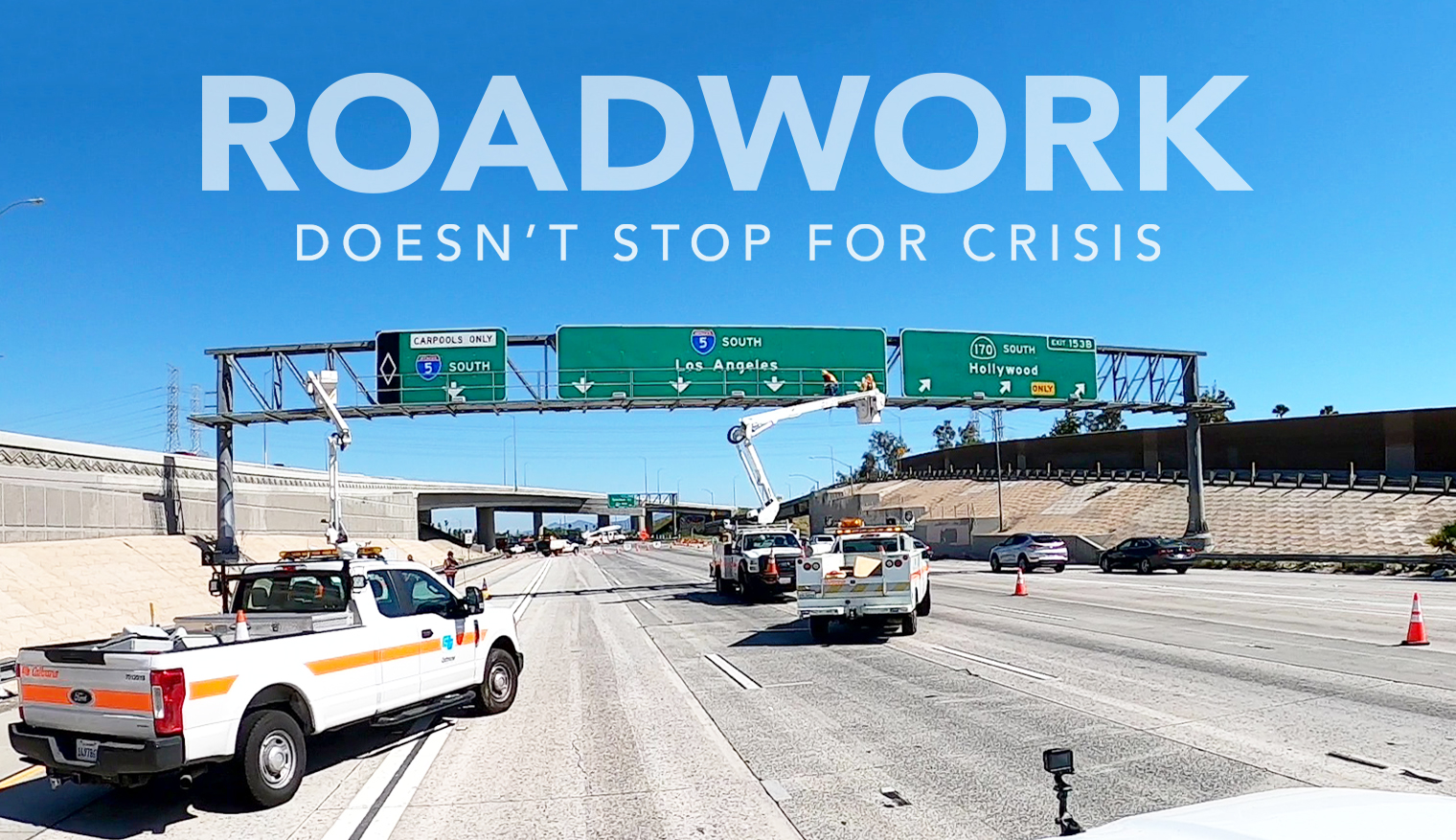 "Lead photo says ""Roadwork Doesn't Stop for Crisis."" Photo depicts Caltrans workers doing work on road signs after the freeway had been shut down."