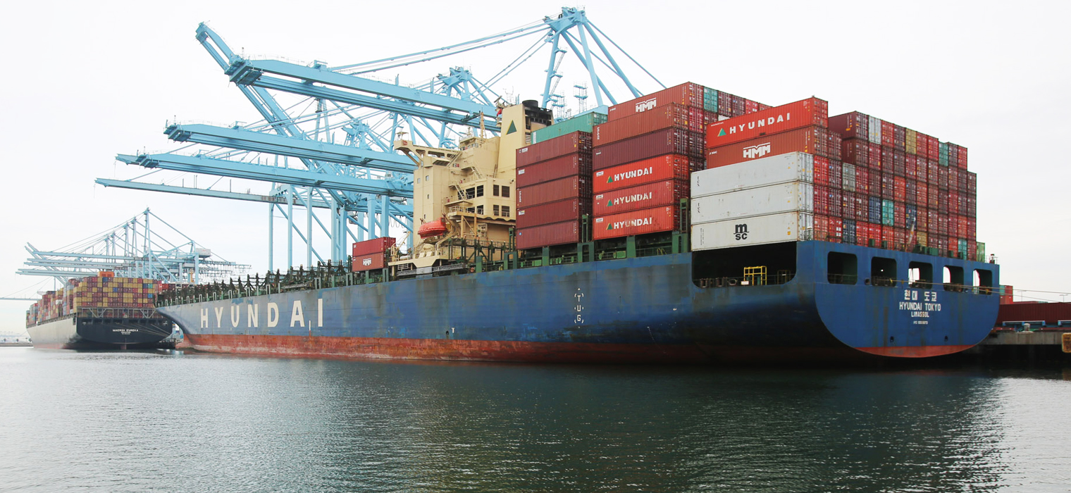 Photo showing a large cargo ship at the port of Long Beach