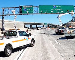 Photo thumbnail of Caltrans maintenance crews working on a nearly deserted Interstate 5 freeway in Los Angeles