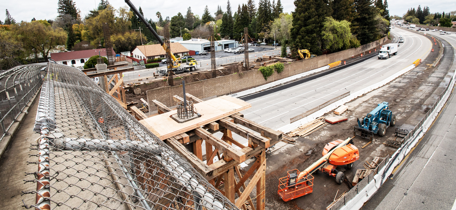Photo taken from a pedestrian overcrossing looking down on construction site, taken during the I-5 Corridor Enhancement Project during March 2020.