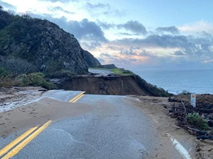 Photo from the morning of January 29, 2021, showing the washout of California's Highway 1, on the Big Sur Coast at Rat Creek, looking south. Debris flow from the Dolan Fire burn scar washed out a 150-foot section of roadway January 28, 2021, causing a full closure.