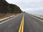After - California Highway 1 at Rat Creek near Big Sur: 86 days later, on April 22, 2021: road-level view of a newly restriped roadway awaits the return of motorists nearly two months sooner than anticipated.